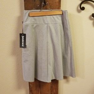 Dresses & Skirts - Beta brand Skirt with attached shorts NWT